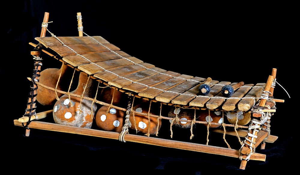 The gyil, a marimba-like instrument with gourd resonators from West Africa.