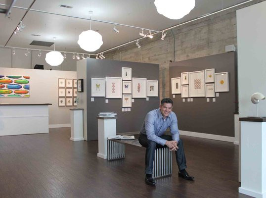 Christopher Marley sits with his Pheromone Gallery in Salem, OR.