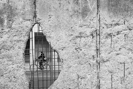 Cyclist Through Rubble