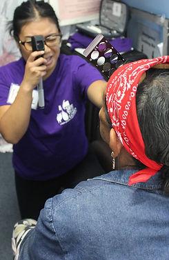 Volunteer examining a patient