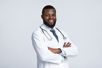 confident-black-doctor-posing-over-white