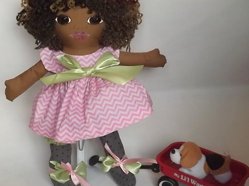 Cloth doll dressed in Pink and Green Dress with Brown Hair