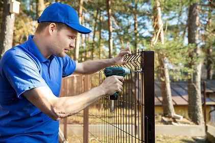 fencing services - worker installing wel