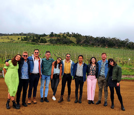 Rosies group in front of Vineyard and limestone quarry at Derwent Estate, Stela Vino