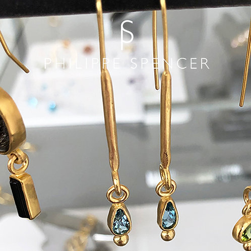 Dangling Aquamarines wrapped in 22K and elongated 20K hoops