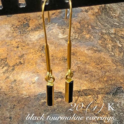Elongated 20K hoop earrings with black tourmalines wrapped in 22K