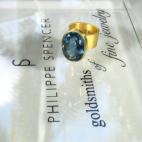 19.25 ct Oval Deep London Blue Topaz with 22K Gold Backless Setting