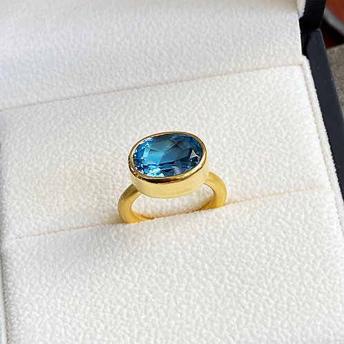 6.8 ct Oval London Blue Topaz set in Pure 22K Gold