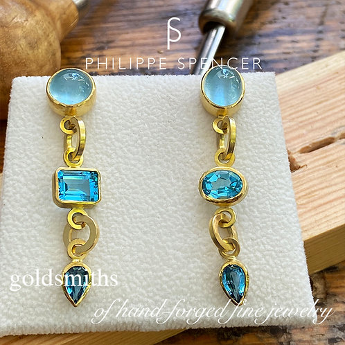 Cabochon Aquamarines  and  Blue Topaz's wrapped in 22K Gold