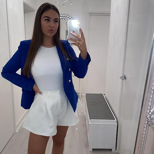 White flare shorts