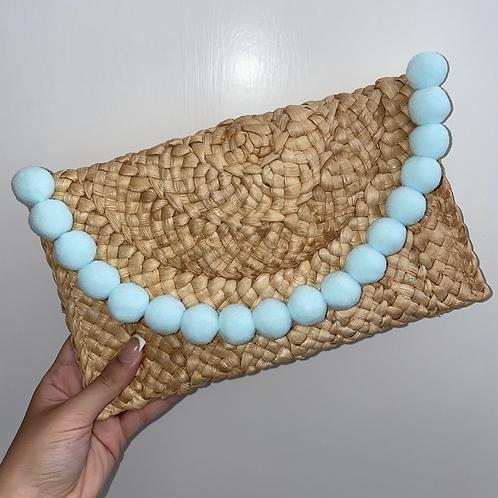 Blue Pom Pom clutch bag