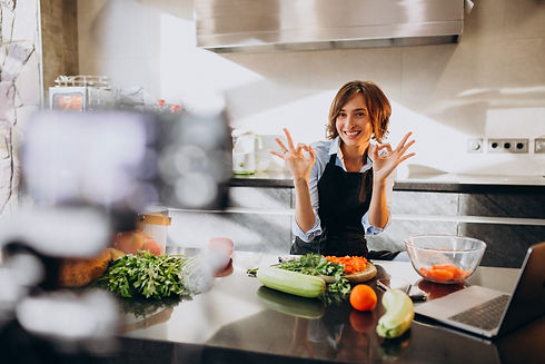 young-woman-videoblogger-cooking-kitchen-filming.jpg