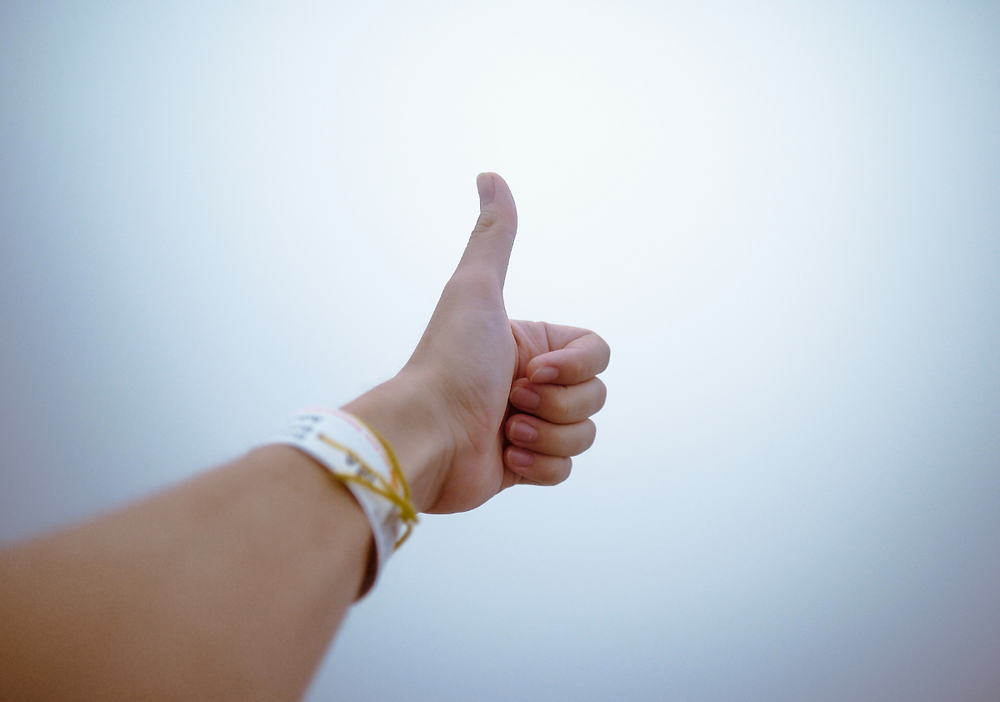 A woman doing a thumbs-up.