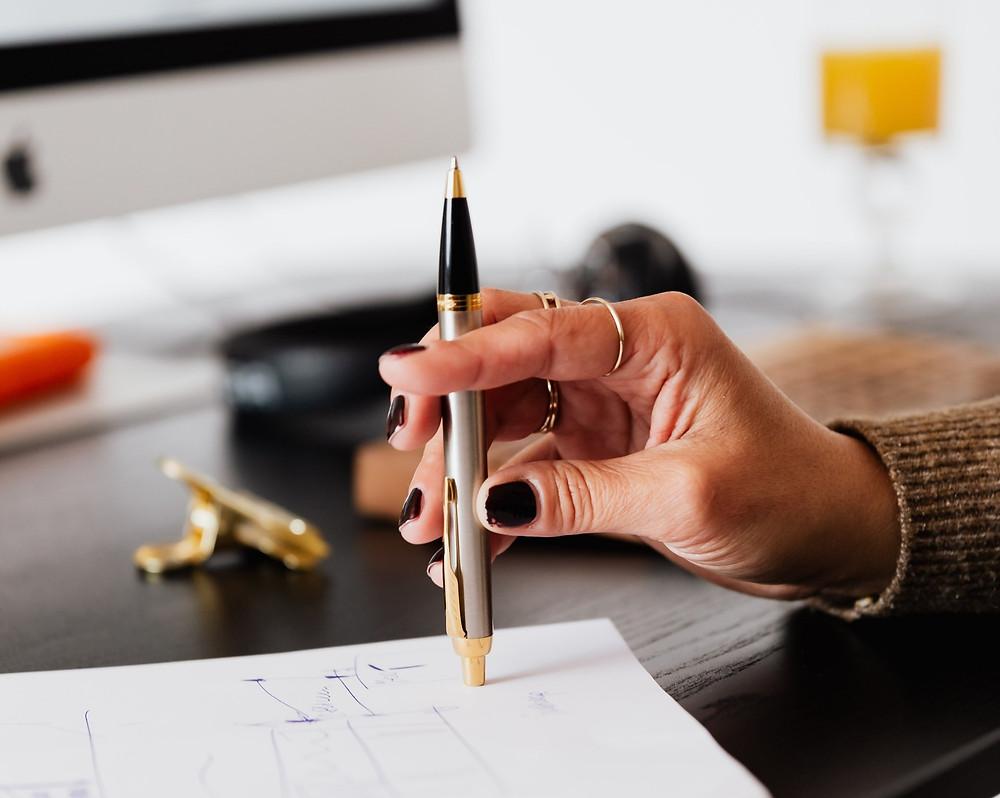 Woman editing her website copy.