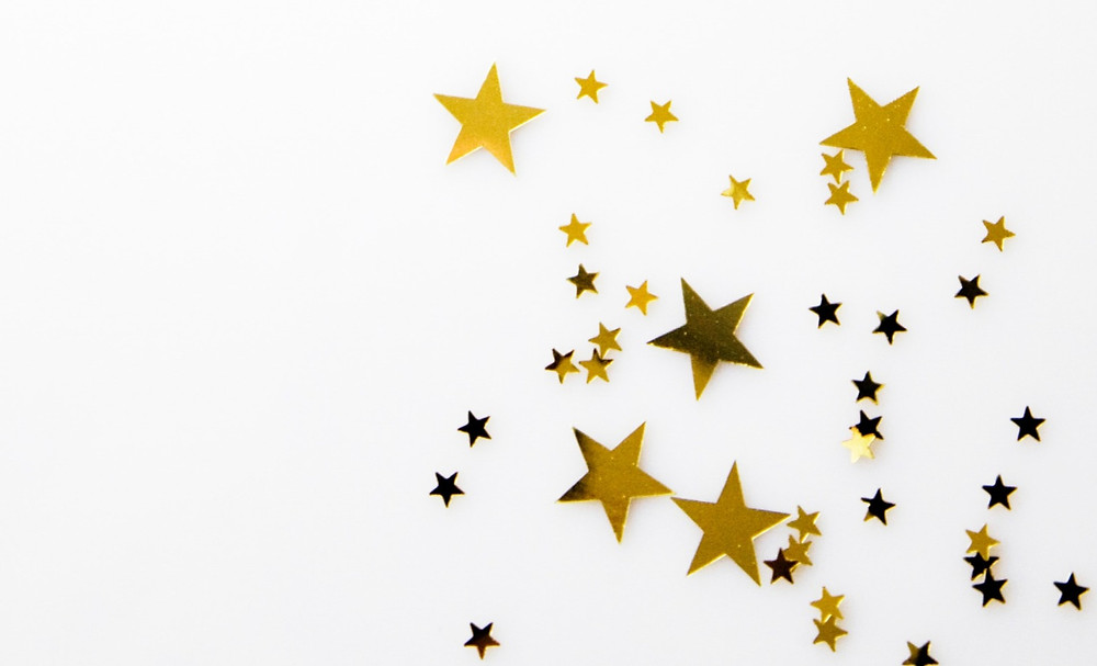Gold stars on a white background