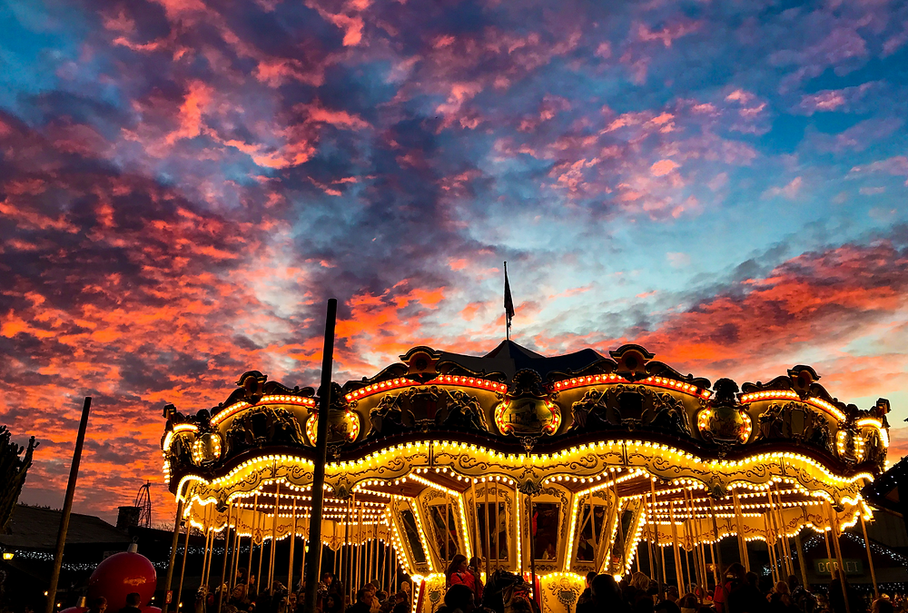 A carousel ride illuminated at night