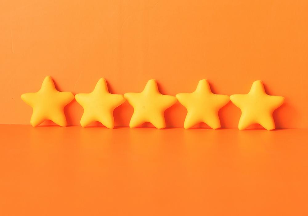 Five yellow stars on an orange background.