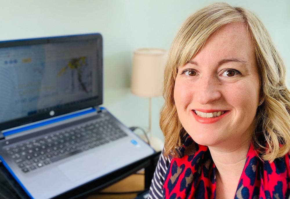 Freelance copywriter Natalie Prior sitting at her desk.