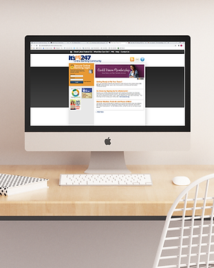 A desktop on a desk displaying the It's Me 24/7 website