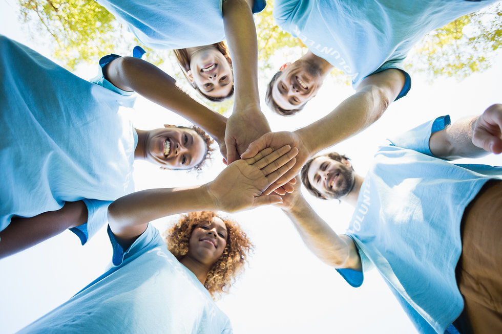 group-of-volunteer-forming-huddles-F4UX5