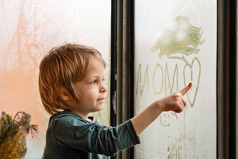 kure-kid-drawing-words-on-a-dew-covered-