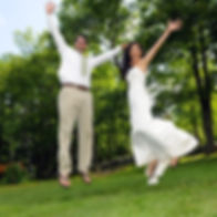 Happy bride and groom jumping