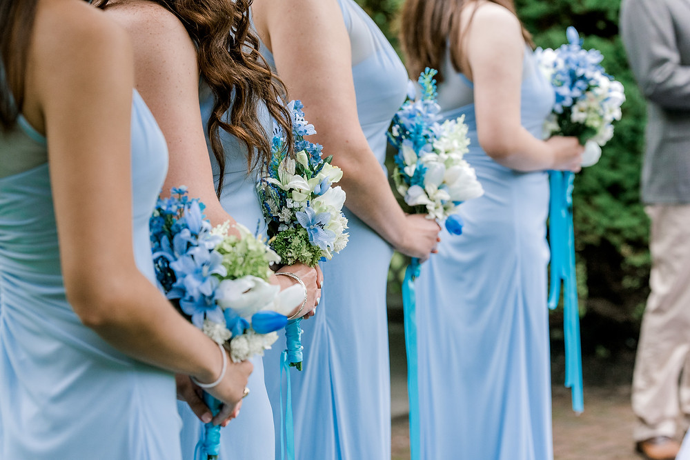 Bridesmaids with blue and white bouquets