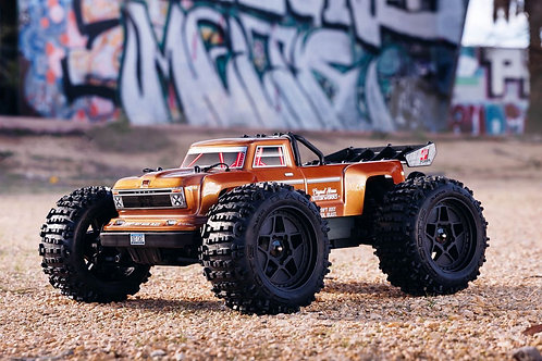 Arrma 1/10 OUTCAST 4x4 4S BLX Brushless Stunt Truck with Spektrum RTR, Bronze