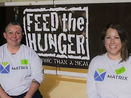 MATRIX employees Julie and Heather volunteer for Feed The Hunger Pack-a-thon