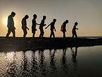 group-of-children-walking-near-body-of-w