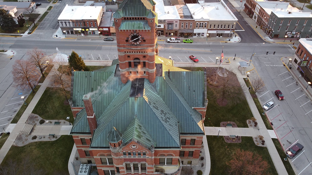 Drone view looking over the west side of the Noble County Courthouse, looking east at Orange Street and Main Street.