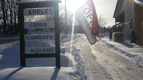 sign displaying offerings and open flag at Winter Store