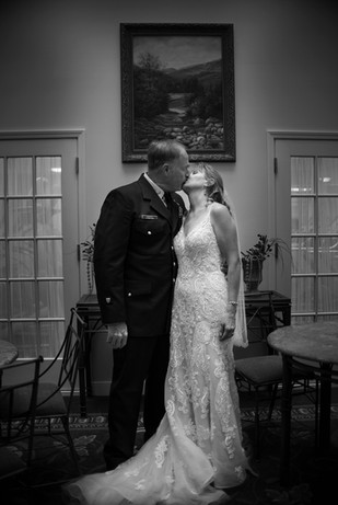Bride and groom posed kiss