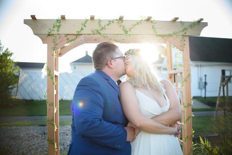 sunshine and rainbow wedding portrait