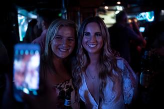bride and bridesmaid posing selfie