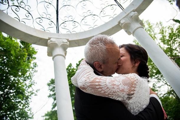 outdoor wedding kiss