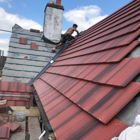 Interlocking Concrete Tiles with a Dry Verge & Hip Tile Detail