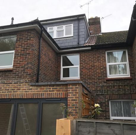 Dormer Roof Including Vertical Tile Detail and Flat Roof