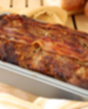 A freshly baked meat loaf with bacon.jpg