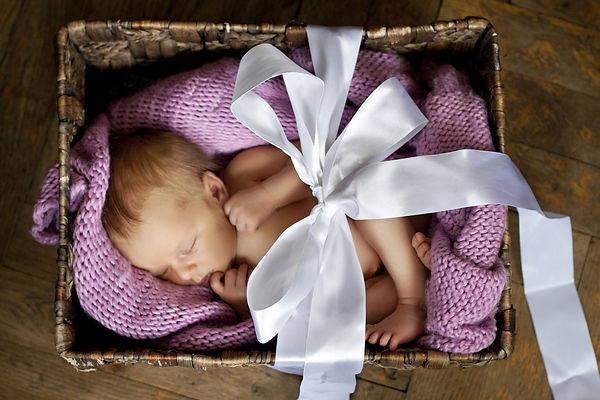 little cute baby in the box with a gift