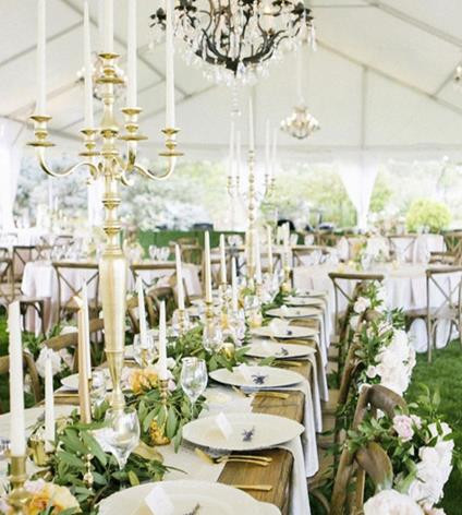 Frame tent with Chandeliers and Farm Tables available at Taylor Rental of Manchester and West Hartford
