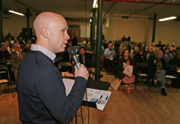 Preservationist Andrew Berman spoke at Wednesday's meeting about the Hudson River Park air rights bill. Minutes later, he informed the crowd the bill had been signed into law. Photo by Sam Spokony