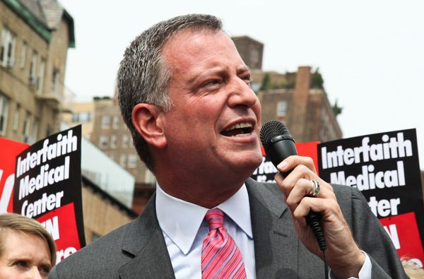 "Bill de Blasio — speaking at a ""Hospitals Not Condos"" rally in the Village last summer — promised to listen to the community and stakeholders, but must do it, the writer says. PHOTO BY TEQUILA MINSKY"