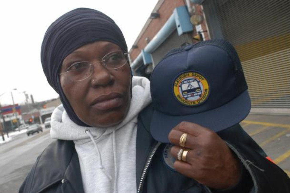 Bus driver Stephanie Lewis refused to cover her religious headscarf or place an MTA logo on it.