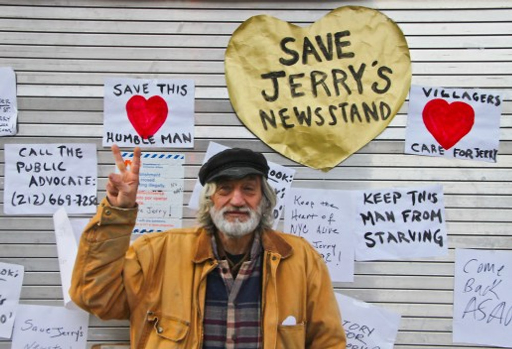Victory! Jerry Delakas at his Astor Place newsstand at Monday's press conference announcing the news that he reached an agreement with the city allowing him to reopen the stand. Photo by Tequila Minsky