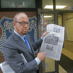 FIGHTING ATTORNEY ARRESTED: Arthur Schwartz after his arrest for removing surveillance cameras from the entry of ninety-two-year-old Ruth Berk's apartment points to Times article—the event also made the Post, News and NBC TV.