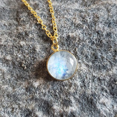 Round Moonstone set in gold
