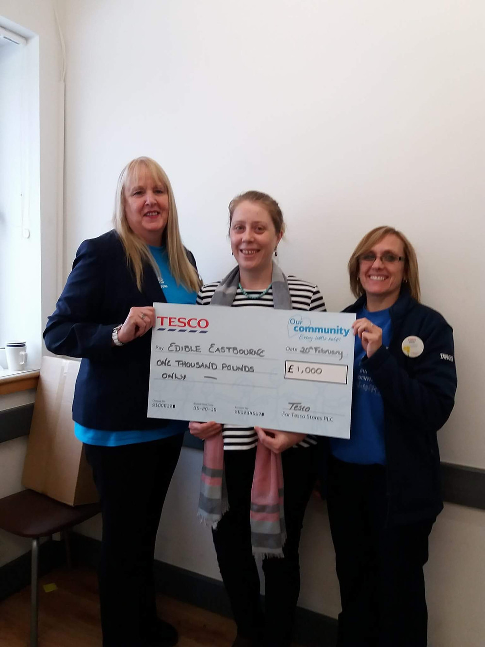 Project Manager Sara Latimer recieveing funding cheque from Tesco community team Irene and Nikki