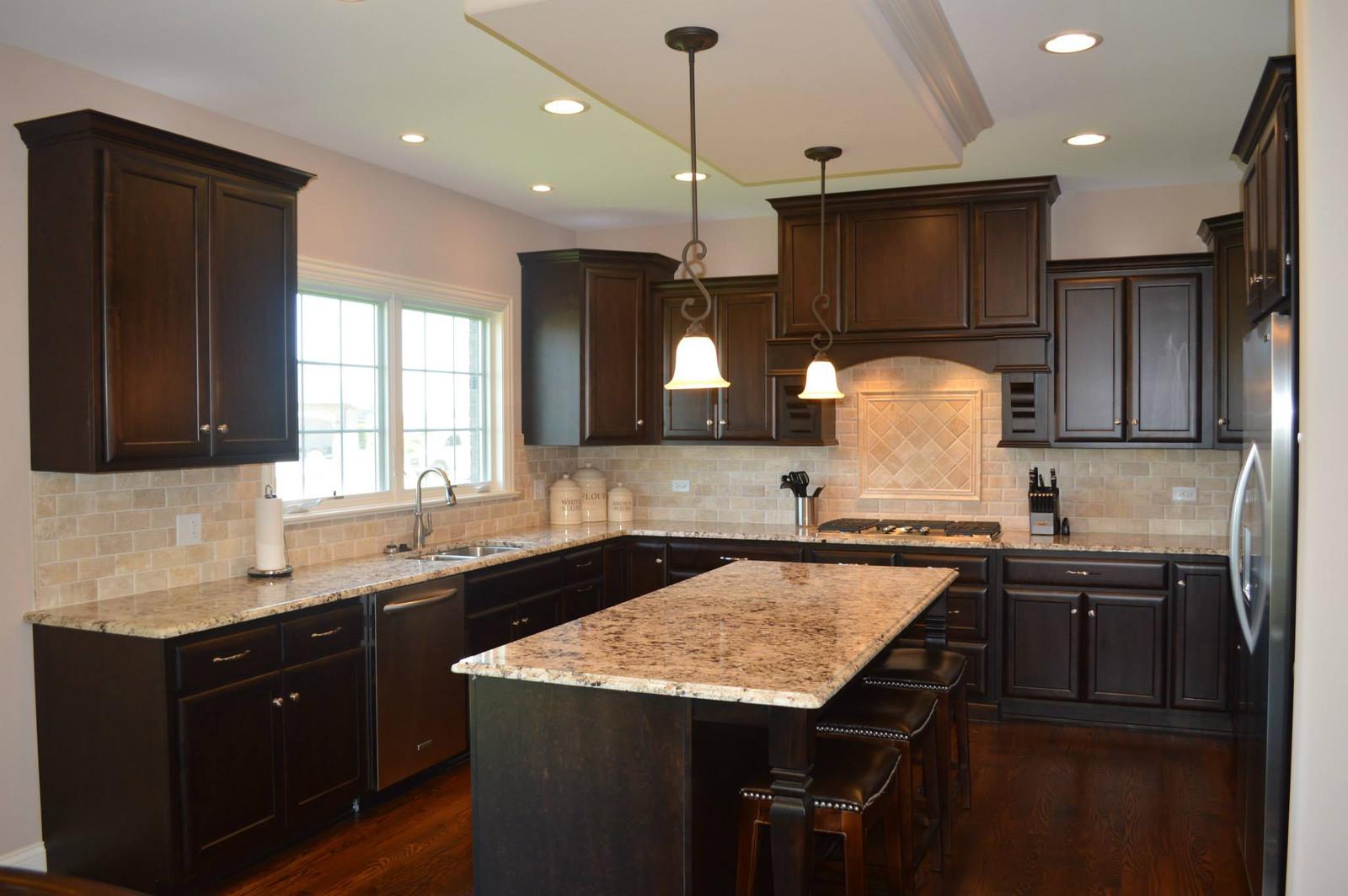 homer glen granite countertops insignia stone kitchen projects giallo ornamental 3cm granite kitchen countertops with ogee edge profile on island and half bullnose edge profile on perimeter