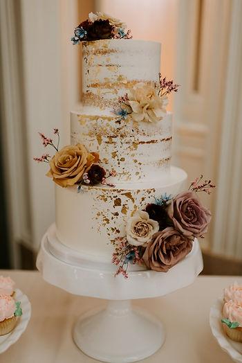 Semi Naked wedding cake with gold leaf